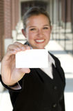 Attractive businesswoman holding a card. Attractive businesswoman holding out a blank card Stock Photography