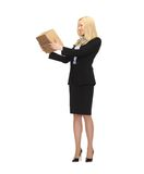 Attractive businesswoman holding cardboard box Stock Photo
