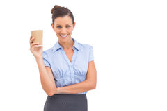 Attractive businesswoman holding coffee cup Stock Photos