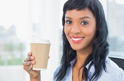 Attractive businesswoman holding coffee Royalty Free Stock Photos