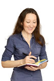 Attractive businesswoman holding documents Stock Photography