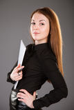 Attractive businesswoman holding a file with documents. Grey background Royalty Free Stock Images