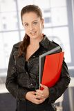 Attractive businesswoman holding folders smiling Royalty Free Stock Photo