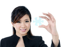 Attractive businesswoman holding jigsaw puzzle Royalty Free Stock Photos