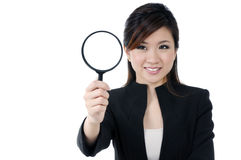 Attractive businesswoman holding magnfying glass Stock Photo