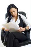 Attractive businesswoman holding papers royalty free stock image