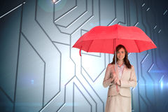 Attractive businesswoman holding red umbrella Stock Photos