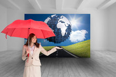Attractive businesswoman holding red umbrella Royalty Free Stock Image