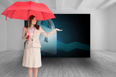 Attractive businesswoman holding red umbrella Stock Photography