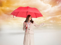 Attractive businesswoman holding red umbrella Stock Images