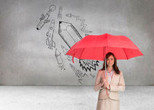 Attractive businesswoman holding red umbrella Royalty Free Stock Images