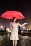 Attractive businesswoman holding red umbrella Royalty Free Stock Photos