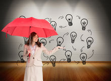 Attractive businesswoman holding red umbrella Royalty Free Stock Photo