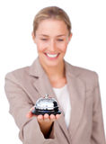 Attractive businesswoman holding a service bell Royalty Free Stock Photos