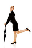 Attractive businesswoman holding an umbrella Royalty Free Stock Photos