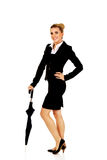 Attractive businesswoman holding an umbrella Royalty Free Stock Images
