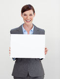 Attractive businesswoman holding white card Royalty Free Stock Images