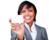 Attractive businesswoman holding a white card Royalty Free Stock Images