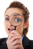 Attractive businesswoman holds magnifying glass Royalty Free Stock Photos