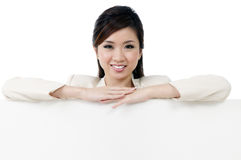 Attractive businesswoman leaning on billboard Royalty Free Stock Photos
