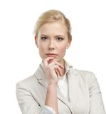 Attractive businesswoman in a light beige suit Royalty Free Stock Image