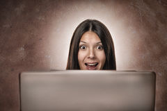 Attractive businesswoman looking in amazement Royalty Free Stock Photography