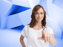 Attractive businesswoman looking and pointing at camera Royalty Free Stock Photos