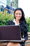 Attractive businesswoman with notebook Stock Image