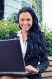 Attractive businesswoman with notebook Stock Photography