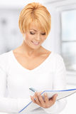 Attractive businesswoman with notebook Royalty Free Stock Photos