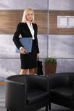 Attractive businesswoman in office lobby Stock Photo