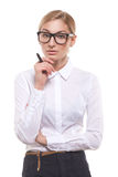 Attractive businesswoman with a pen Stock Images