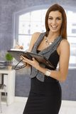 Attractive businesswoman with personal organizer Stock Photo