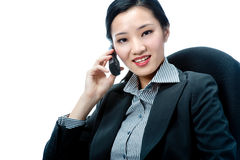 An attractive businesswoman with phone Stock Images