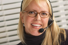 Attractive Businesswoman with Phone Headset Royalty Free Stock Photo