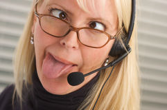 Attractive Businesswoman with Phone Headset royalty free stock photography