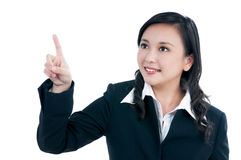 Attractive businesswoman pointing Royalty Free Stock Images