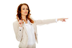 Attractive businesswoman pointing her finger. Stock Image