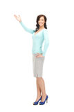 Attractive businesswoman pointing her hand Stock Image