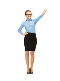 Attractive businesswoman pointing her hand Royalty Free Stock Image