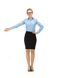 Attractive businesswoman pointing her hand Royalty Free Stock Images