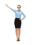 Attractive businesswoman pointing her hand Stock Images