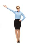 Attractive businesswoman pointing her hand Royalty Free Stock Photos