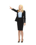 Attractive businesswoman pointing at something Royalty Free Stock Photo