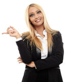 Attractive businesswoman pointing to the copyspace. Closeup of a very attractive businesswoman  pointing to the copyspace, isolated on white background Stock Photos