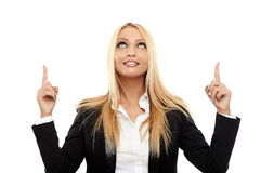 Attractive businesswoman pointing to the copyspace. Closeup of a very attractive businesswoman  pointing to the copyspace, isolated on white background Royalty Free Stock Photo