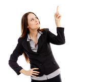 Attractive businesswoman pointing to the top of the image Royalty Free Stock Photography
