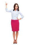Attractive businesswoman pointing up Stock Photo