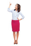 Attractive businesswoman pointing up Stock Image