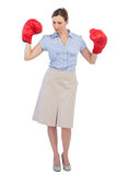 Attractive businesswoman posing with boxing gloves Stock Images